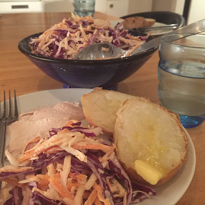 coleslaw served with jacket potato and cold meat