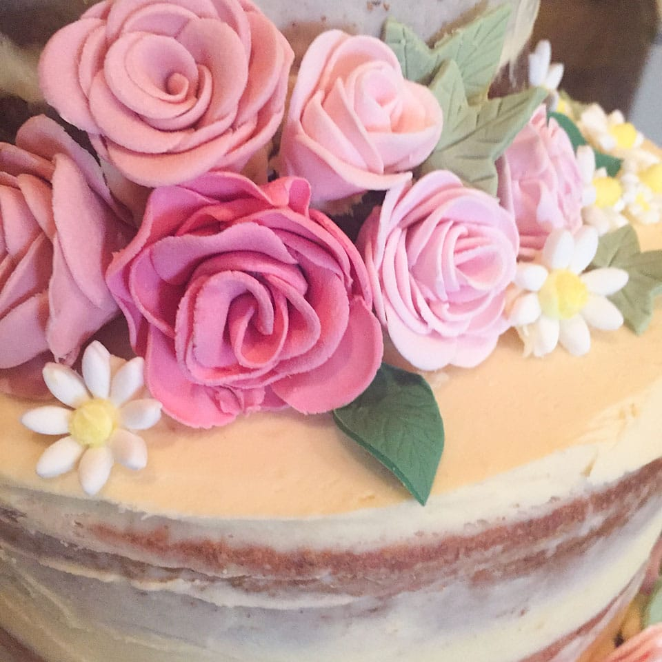 closeup of sugarpaste flowers on a wedding cake